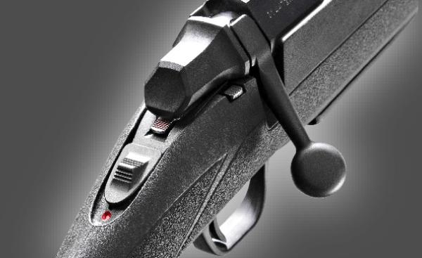widok przycisku znajdującego się na broni służącego do zabezpieczenia broni